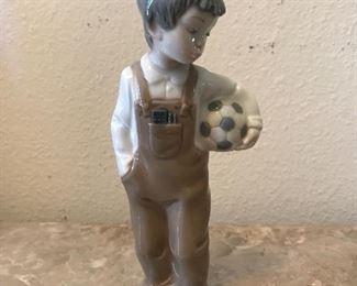 Lladro NAO Boy holding soccer ball