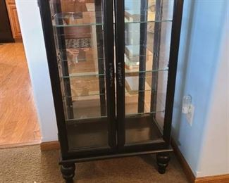 Black storage Cabinet with glass doors and shelves 43X24X12