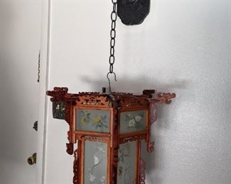 Hanging Chinese lanterns with plastic dragon  hanger.  Hexagonal Lantern Circa 1950's there are two of these. Priced at $395 each