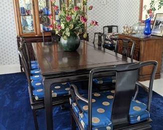 George Zee Klin Dired Mid Century Black Lacquered Dining Room Table and Eight Chairs with Blue and Gold emblem cushions .  Solid Wood Circa 1950's  Prices $4000