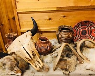 authentic cow skull, animal furs, and Native American baskets