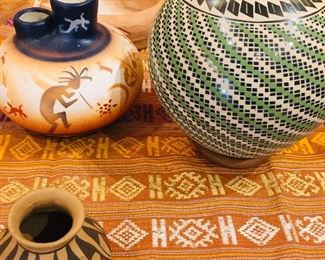 back right pot is by Maria Ortiz, front pot is by Helen Shendo,