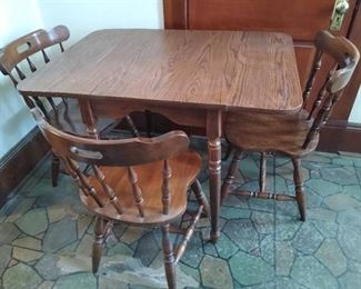 Dining table W/ drop leafs & 3 chairs