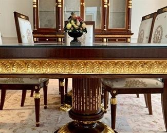 """$4200 - Parcel gilt double pedestal dining table in the style of EJ Victor; with acanthus leaf carvings ; custom glass top; 31.5"""" H x 98.5"""" W x 47.5"""" D"""