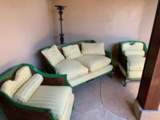 Antique English Chinoiserie painted double wall cane settee and armchairs with down cushions