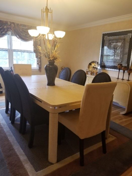 Dining room table and buffet.  Fiberglass mesh overlay.  Table with 2 leaves and 8 chairs.