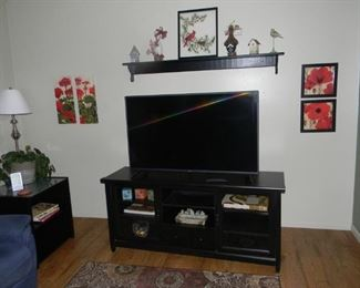 More of this black furniture   / There are several TV's