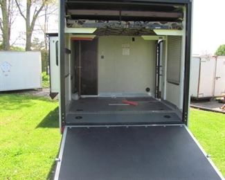 Toy hauler beavertail back end or cargo bay. has a let down double sofa and bed when not used for Motorcycles or cargo with a screen on back door.