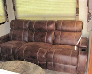 double incliner sofa in living area.