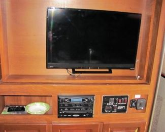 flat screen TV and stereo system.
