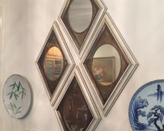 Four-piece wall hanging and decorative plates.