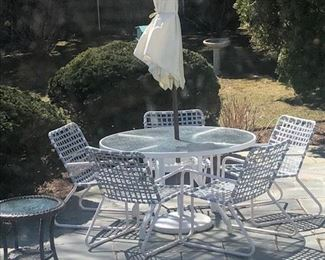 Vintage Brown Jordan outdoor table and 5 pool strap chairs, Umbrella and base