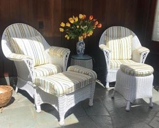 2 upholstered wicker armchairs  and 2 ottomans