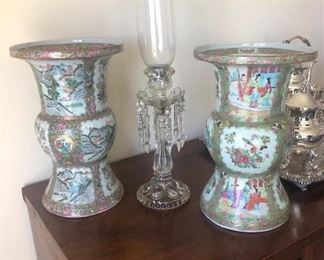 An unmatched pair of Rose Gu vases. One with highly decorative landscape painting
