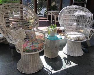 Vintage wicker swivel peacock chairs