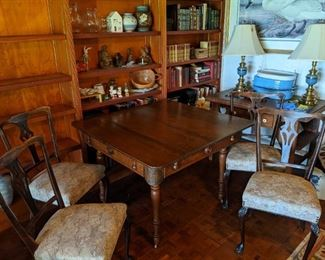 Wood table and upholstered chairs
