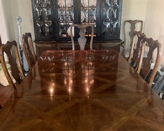 Heritage dining room table; can be extended to seat 12; 3 leaves, tabletop pads included