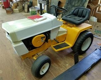 International Harvester/ Cub riding tractor with plow