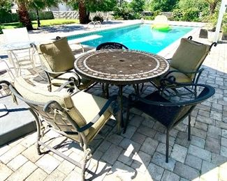 "9-	Outside table tile top with 5 chairs 4""R, 3 rockers, 2 wicker		$250"