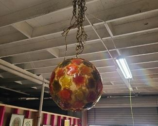This Vintage 1960's Wild Flower Power Swag Lamp (fiberglass & lucite) will bring a warm, unique glow to your room decor.  Shows best with a clear light bulb, features popular-color adornments. RARE FIND!!!