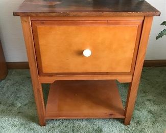 Nice little end table with drawer.  1950's