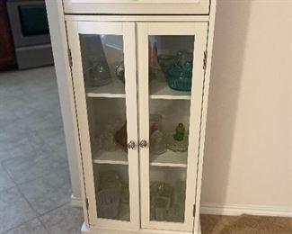 Small slender white cabinet