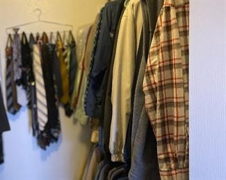 Man's closet with shirts and ties