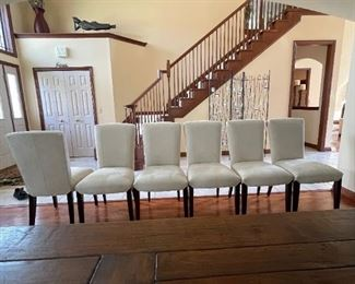 """Six Arhaus Suede Dining Chairs. Measurements: Seat: 20"""" wide, 18"""" long. Chair: 39"""" tall, floor to seat: 21"""". Mint Condition. $900"""