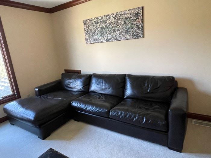"""Arhaus Espresso Leather Couch. Measurements: 9' 11"""" x 2' 11"""" and chase part 5' 11"""". Excellent Condition. $2000"""