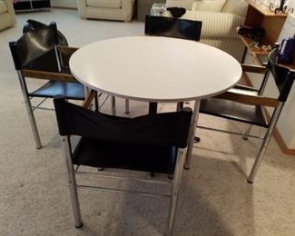 Chrome legged dining set with 4 chairs