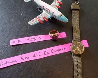 Tin United airplane, 10 k ring and Vietnam era W.C. co. Compass