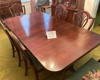 Antique dinning table with 6 embroidered chais $520