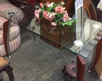 glass top table with interesting legs