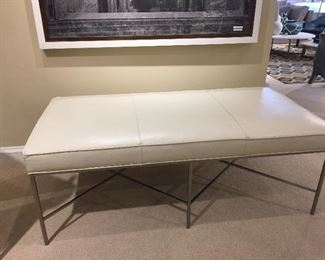 Leather designer bench with brushed silver base. Dimensions: W:61 D:33 H:25.
