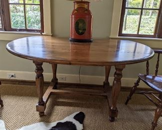 Antique, oval wooden  French farm table.