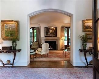Entryway of the house, with a pair of antique tortoise shell, faux painted demilune tables.