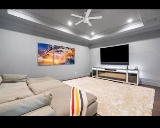 Artwork, rug, sofa