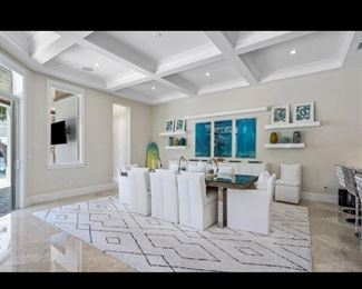 Rug, dining table, chairs, artwork