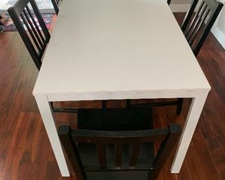 IKEA Vangsta extendable table. Made of steel and melamine, this table is very sturdy and stain-resistant. Seats 4, or has an easily extended leaf to seat 6. Asking $100.