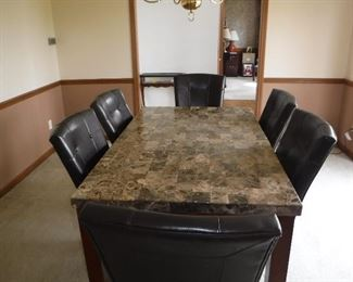 Marble top dining table with 6 leather chairs - purchased within last year - mint condition