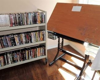 Tremendous collection of DVD movies, movie CDs, tv series and record albums.  2 library carts to sort your collections.   //   Home of an artist with many artistic touches and her drafting table table