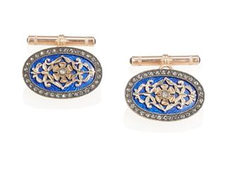 """1002 A Pair Of Russian Enamel And Diamond Cufflinks 18k rose gold and silver; Marked to loop verso Each centering a yellow gold rosette in a blue enamel ground surrounded by rose-cut diamonds, with box Each: 1"""" H x .625"""" W 16.5 grams 2 pieces Estimate: $600 - $800"""