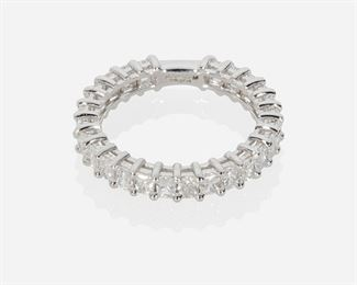 1005 A Diamond Ring Platinum Set with twenty-six radiant-cut diamonds totaling 1.67ct and graded F- G color and SI clarity Ring size: 7.5 4.5 grams Estimate: $2,500 - $3,500