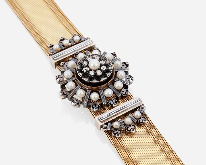 """1001 A French Diamond And Pearl Bracelet/Brooch Silver & 18k yellow gold; Stamped with French assay marks Centering a silver-topped gold circular element set with old mine-cut diamonds and seed pearls that may be removed and worn separately as a brooch Bracelet: 6.5"""" L x 0.75"""" W; Brooch 1.5"""" 55 grams 3 pieces Estimate: $3,000 - $5,000"""