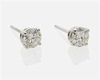 1009 A Pair Of Diamond Stud Earrings Platinum Set with two full-cut round diamonds totaling 1.26ct, and graded H-I color and VS-SI clarity 2.67 grams 2 pieces Estimate: $2,000 - $3,000