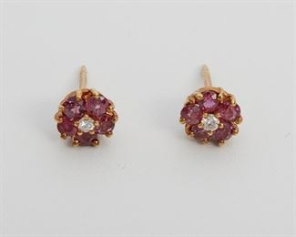 """2002 A Pair Of Tiffany & Co. Ruby And Diamond Earrings 18k yellow gold Centering two full-cut round diamonds totaling approximately 0.10ct and graded F-G color, VS clarity, further surrounded by a halo of ten round rubies totaling approximately 0.80ct .25"""" W 2 grams 2 pieces Estimate: $500 - $700"""