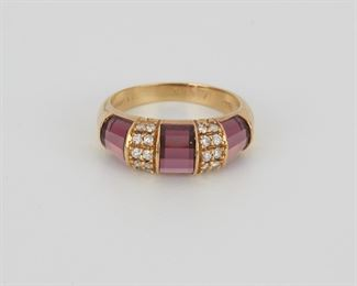 2004 A Tiffany & Co. Pink Tourmaline And Diamond Ring 18k yellow gold; Signed: Tiffany & Co / 6343 Set with three faceted pink tourmaline inlaid segments alternating with two segments of twenty full-cut round diamonds totaling approximately 0.30ct and graded F-G color, VS clarity Ring size: 6 4 grams Estimate: $600 - $800