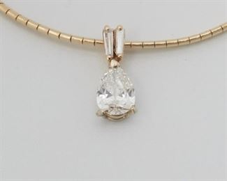 """2003 A Pear-Shaped Diamond Necklace 14k yellow gold With detachable pendant centering a pear-shaped diamond weighing 1.34ct with GIA certificate stating H color and SI2 clarity topped with two baguette-cut diamonds 18"""" L 15 grams 2 pieces Estimate: $3,000 - $5,000"""