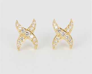 """2006 A Pair Of Diamond """"X"""" Earrings 18k yellow gold Set with twenty-six full-cut round diamonds totaling approximately 1.80ct, and graded J-K color and VS clarity .75"""" H x .5"""" W 6.3 grams 2 pieces Estimate: $600 - $800"""