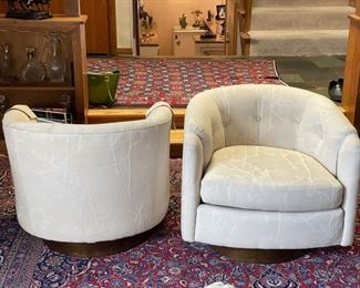 """Pair of vintage Dansen Contemporary Milo Baughman-style swivel bucket chairs with wood base. Measures 30""""W x 30""""D x 26""""H. Seat height is 16""""H. Photo 3 of 4"""
